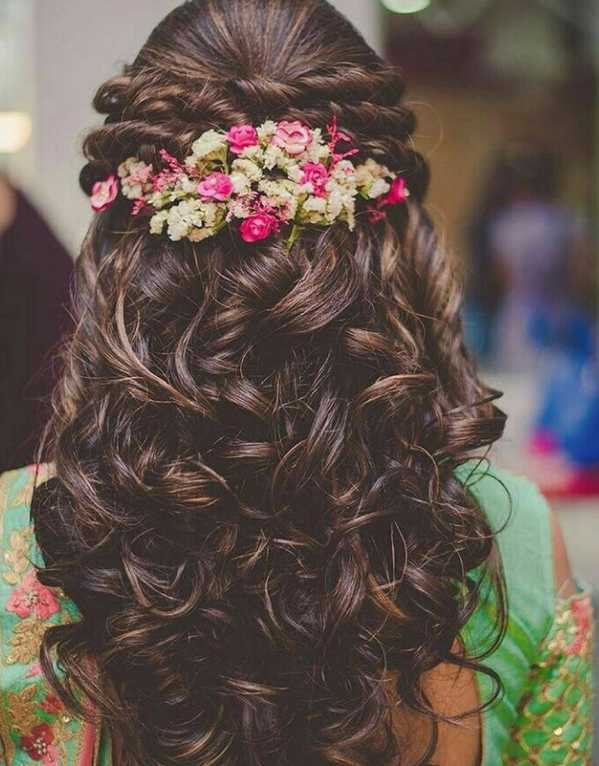 Give your thick curls a few front twists and add some florals for your sagan ceremony