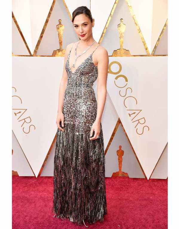 Gal Gadot dripped in metallic wearing this dramatically layered and sequined number from the SS'18 line