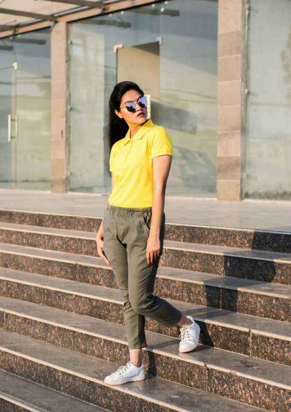 yellow colored polo tee with olive green jogger pants