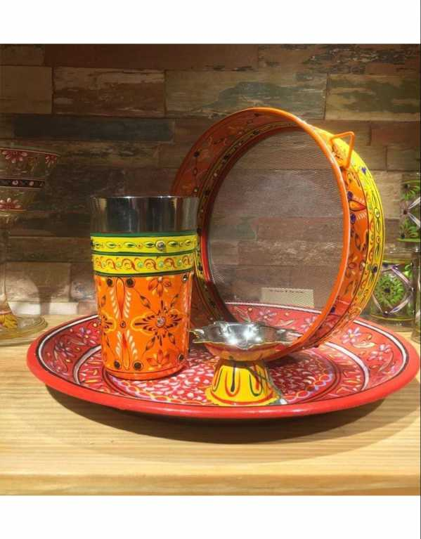 A beautifully hand-painted thali that is washable