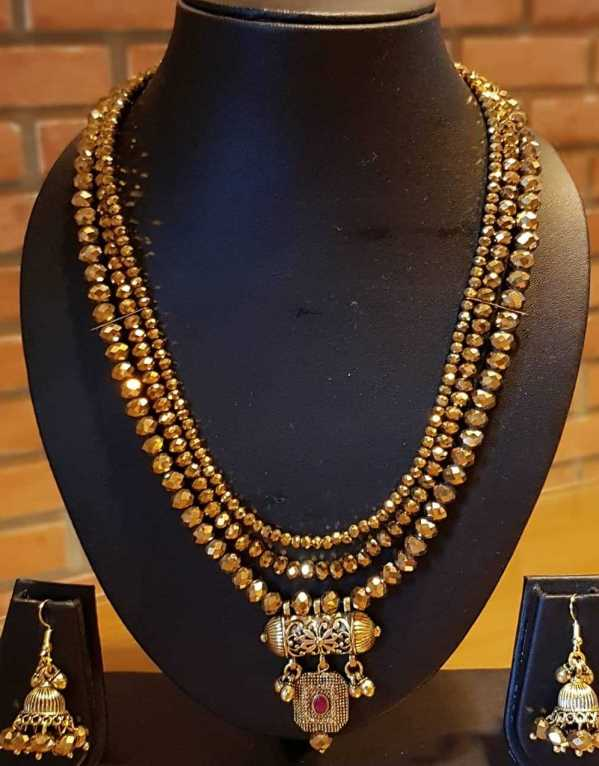 Statement traditional necklace and earring jewelry