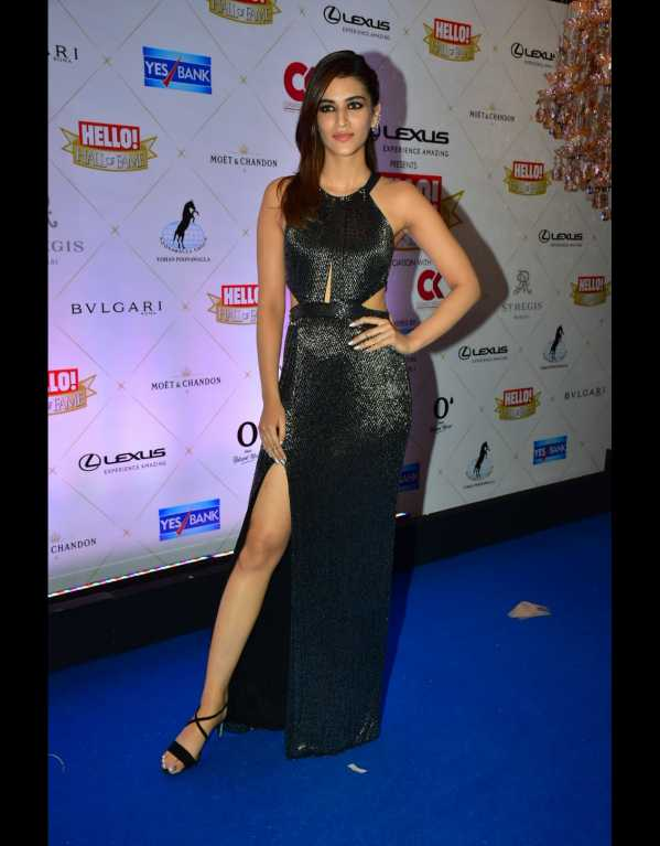 Always getting the slit right! Kriti Sanon in a Sharnita Nandwana thigh-high slit dress