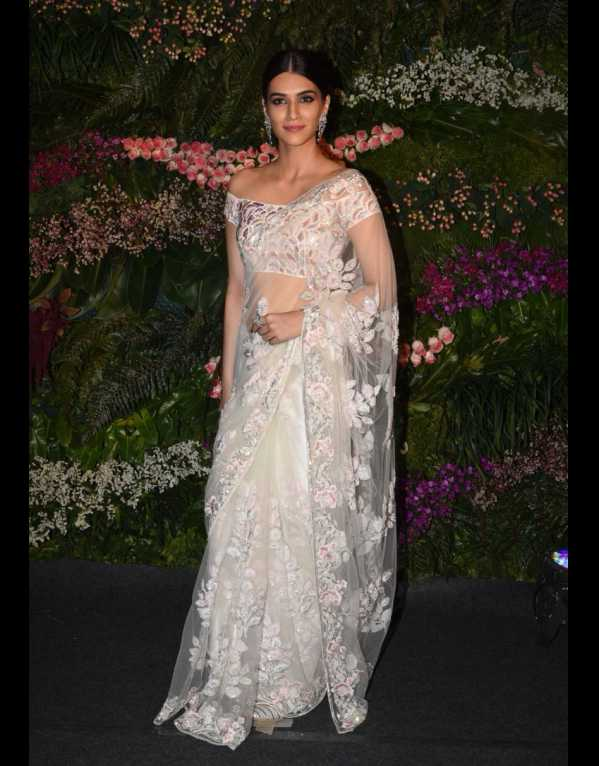 Kriti Sanon in a thread and pearl embroidered ivory saree by Manish Malhotra