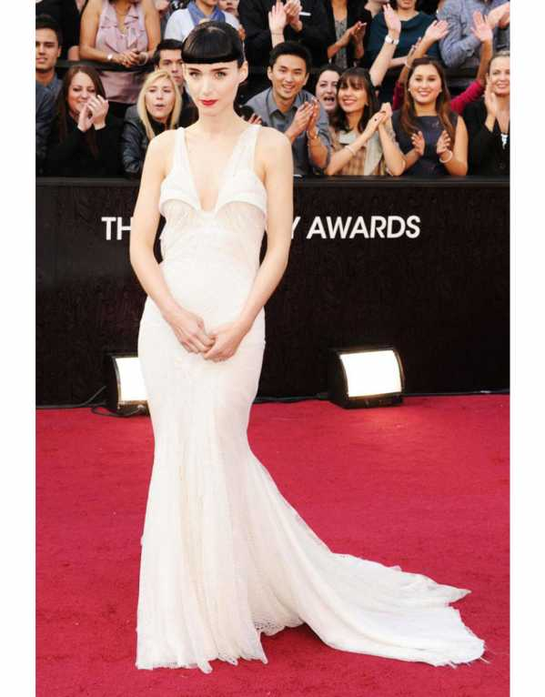 Rooney Mara in an ethereal white gown paired with structured bangs and red lips at the Oscars in 2012