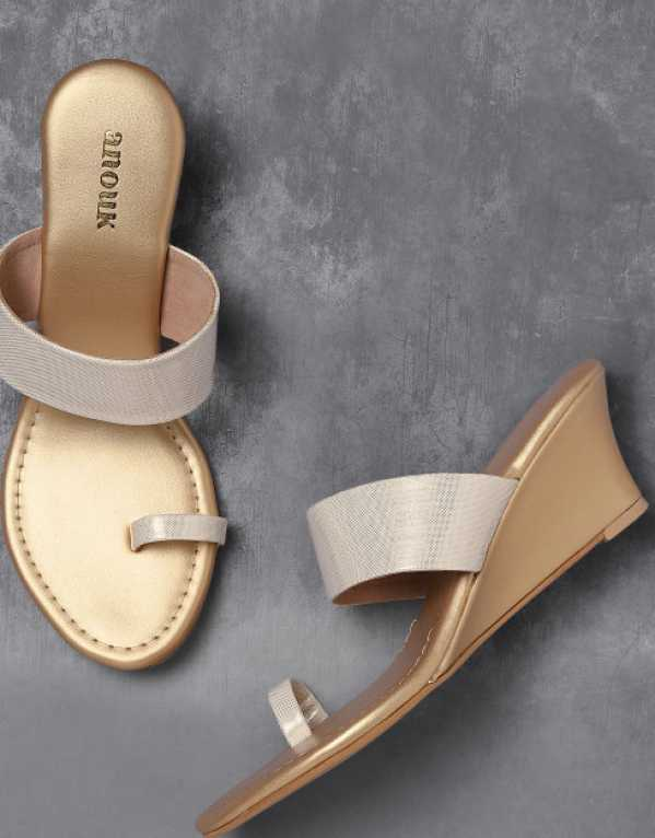 3. Anouk Off-White & Gold-Toned Printed Wedges
