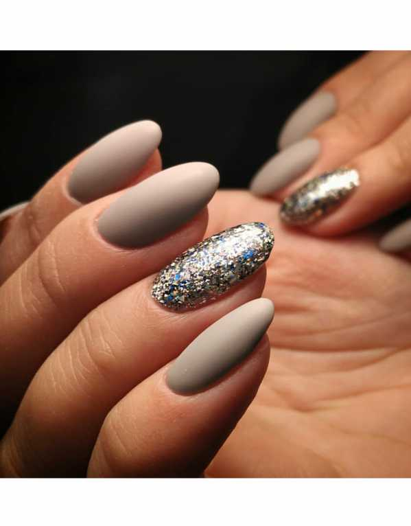 Ace your evening manicure with classy, matte grey nails. Take the look up a notch by adding a disco nail each.