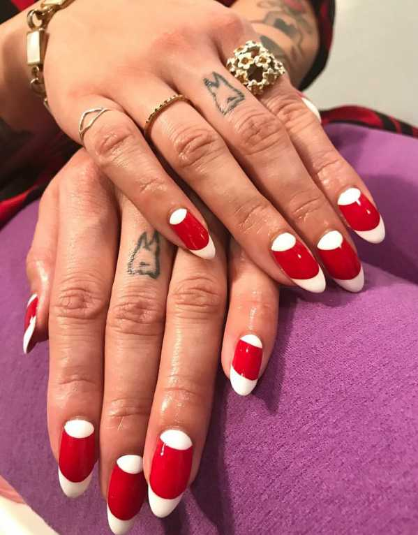 Give your French tips a cute, candy twist by adding an extra, white half-moon and painting the rest of the nail red.