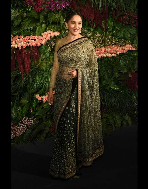 The lady who doesn't seem to age! Madhuri Dixit in a Tarun Tahiliani saree