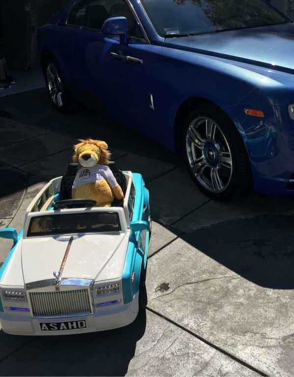 And a beaming Rolls Royce with a custom license plate with his name