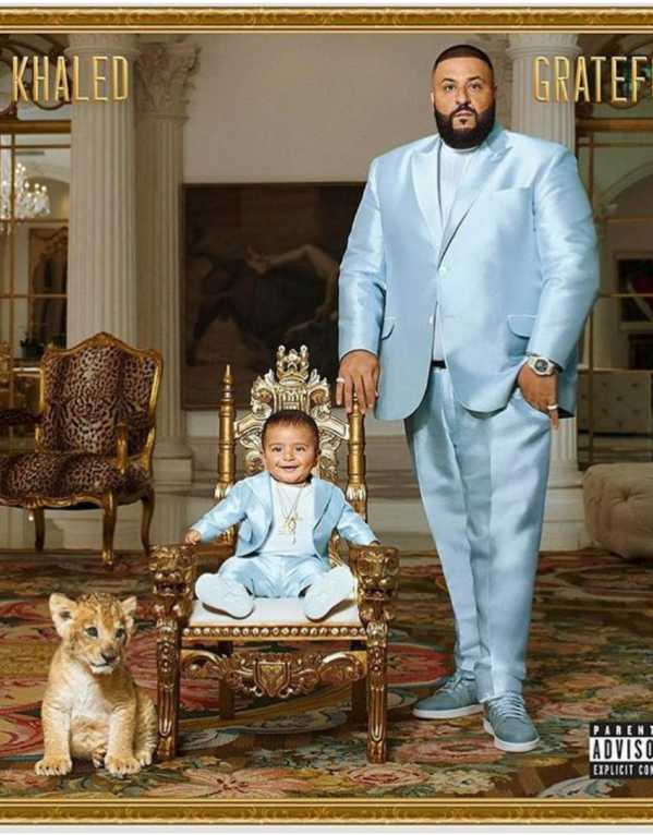 Twinning with Daddy in yet another Gucci suit on the album cover of Grateful